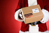 Santa: Holding A Package Ready For Shipping — Stock Photo