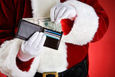Santa: Pulling Cash Out Of Wallet — Stock Photo