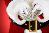 Santa: Holding Out A Money Fan — Stock Photo