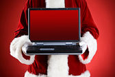 Santa: Holding A Laptop With Blank Screen — Stock Photo