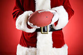Santa: Holding An American Football — Stock Photo