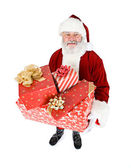 Santa: Santa Holds Stack of Gifts — Stock Photo