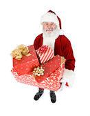 Santa: santa enthält stapel von geschenken — Stockfoto