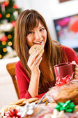 Christmas: Baker Eating Cookie with Coffee — Stock Photo