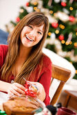 Christmas: Putting Ribbon On Wrapped Bread — Stock Photo
