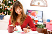 Christmas: Writing Holiday Cards at Table — Stock Photo