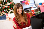 Christmas: Home Shopper with Credit Card — Stock Photo