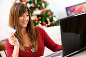 Christmas: Woman Paying For Purchase with Credit Card — Stock Photo