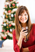 Christmas: Woman Holding Wine Glass — Stock Photo