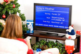 Christmas: Woman Watching Winter Weather Report — Stock Photo