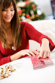 Christmas: Woman Wrapping Small Gift — Stock Photo