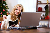 Christmas: Woman Taking Notes During Online Shopping — Stock Photo