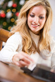 Christmas: Looking Up Addresses For Cards — Stock Photo