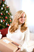 Christmas: Woman Holding Shipping Box — Stock Photo