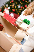 Christmas: Putting Wrapped Gifts In Box — Stock Photo