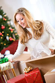 Christmas: Woman Packing Gifts In Shipping Box — Stock Photo