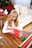 Christmas: Woman Wrapping Christmas Gift — Stock Photo