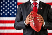 Politician: Holding a Football — Stock Photo