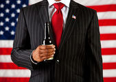 Politician: Holding a Beer Bottle — Stock Photo