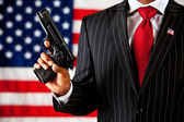 Politician: Holding a Gun Aloft — Stock Photo