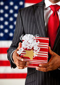 Politician: Holding a Christmas Present — Stock Photo
