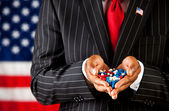 Politician: Holding a Handful of Precribed Capsules — Stock Photo