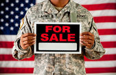 Soldier: Holding Blank For Sale Sign — Stock Photo
