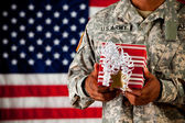 Soldier: Holding a Wrapped Gift — Stock Photo