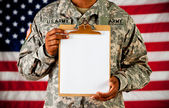 Soldier: Holding a Blank Clipboard — Stock Photo