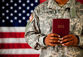 Soldier: Holding a Bible in Front of Him — Stock Photo
