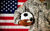 Soldier: Holding a Soccer Ball — Stock Photo
