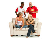 Fans: Men Annoyed Women Are On Couch — Stock Photo