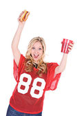 Football: Excited Fan Holding Up Snacks — Stock Photo