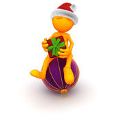 Orange Guy: Sitting on a Christmas Ornament with Present — Stock Photo