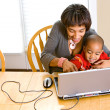 Family: Parent Teaching Boy To Use Computer — Stock Photo #36118501
