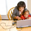Family: Parent Teaching Boy To Use Computer — Stock Photo