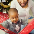 Family: Cute Boy Unwrapping Christmas Gift — Stok fotoğraf
