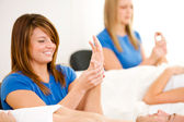 Massage: Woman Works on Hand Massage — Stock Photo