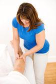 Massage: Man Receives Leg Massage — Stock Photo