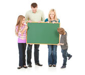 Family: Family Holds Up A Blank Chalkboard — Stock Photo