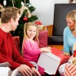 Christmas: Girl Unwrapping Large Gift — Stock Photo