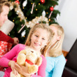 Christmas: Girl Gets Stuffed Dog for Christmas — Foto de Stock