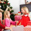 Christmas: Family Opening Christmas Presents — Stock Photo #36130595