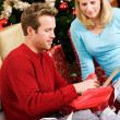 Christmas: Man Opening Gift — Photo