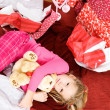 Christmas: Girl Lying On Floor In Wrapping Paper — Foto de Stock