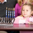 Hanukkah: Little Girl Looks at Candles — Stock Photo #36132387