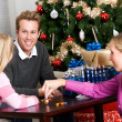Holidays: Family Playing Dreidel Game — Stockfoto