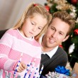 Holidays: Dad Watches Girl Light Candles — Stok fotoğraf