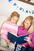 Hanukkah: Child Reading Story with Mother — Stock Photo