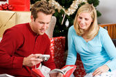 Christmas: Man Gets New Camera For Christmas — Stock Photo